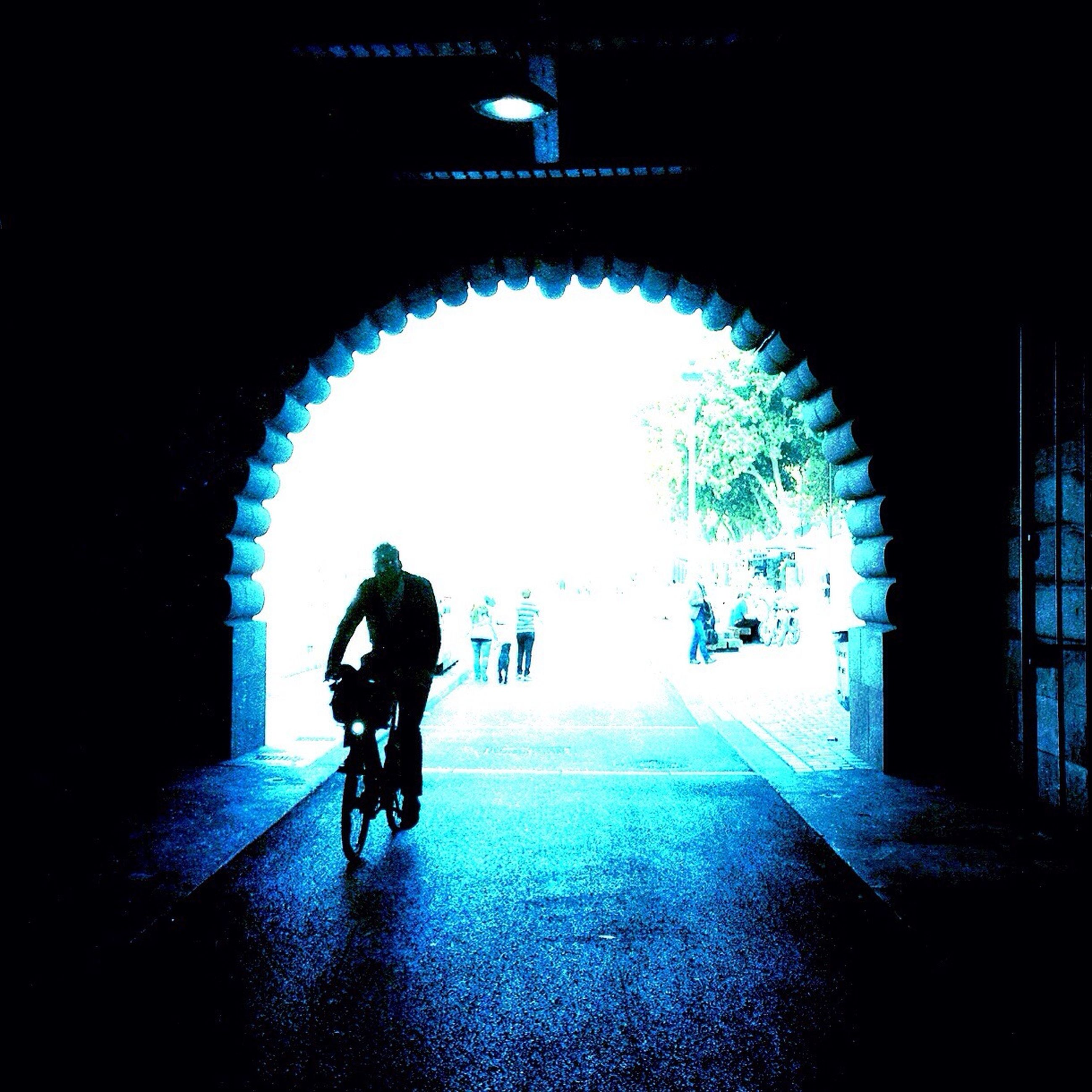 full length, lifestyles, tunnel, arch, indoors, leisure activity, men, rear view, walking, architecture, built structure, silhouette, boys, person, archway, standing, childhood