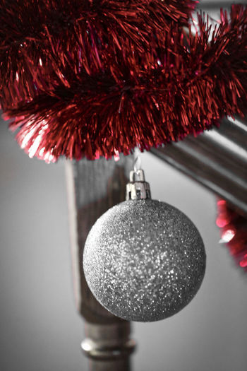Close-up of christmas decoration hanging on ceiling