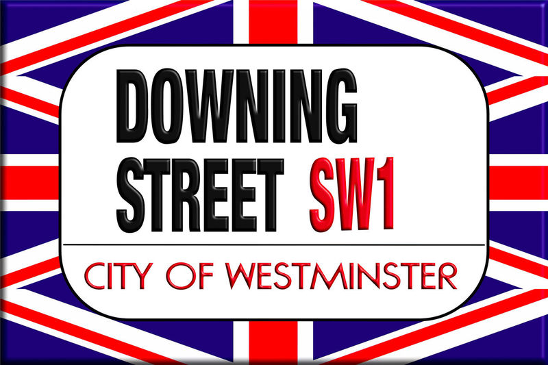 Downing street sign in the background of the Union Jack Communication Sign Red Text Western Script White Color Blue Close-up No People Capital Letter White Background Studio Shot Striped Store Sign Day Sale Business Shopping Full Frame Retail  Message Consumerism