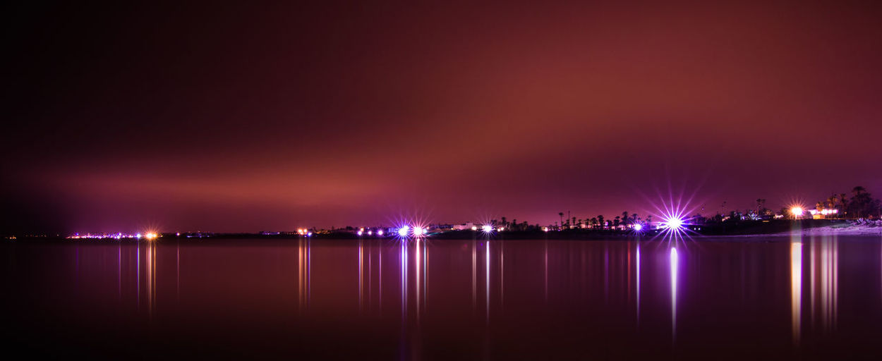 Mirror City Cityscape Illuminated Nature Night No People Outdoors Reflection Sea Sky Water