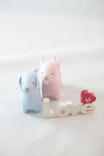 Love Toys Animal Themes Close-up Finance Indoors  No People Pink Color Representation Soft Toys Still Life Studio Shot Stuffed Toy Table Toy White Color