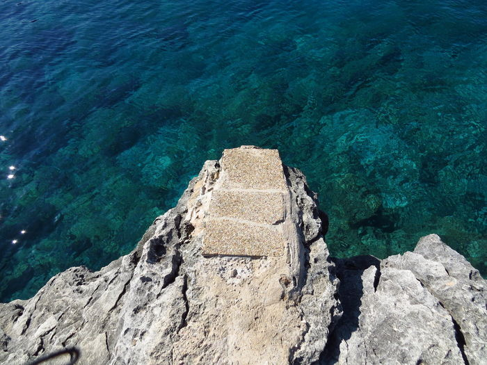 Dive In Jump Mallorca Mediterranean Sea Stairs Steps Baleares Balearic Islands Dare Dive On In High Angle View Jump In Jump In The Water  Jumping Menorca Ocean Plank Rock Rock Formation Sea Take-off Travel Destinations Turquoise Colored Venture Water