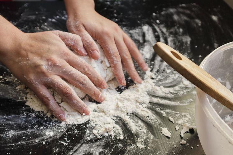 High angle view of people preparing food in water