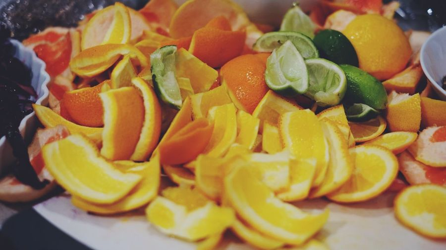 Close-up of sliced citrus fruits on table