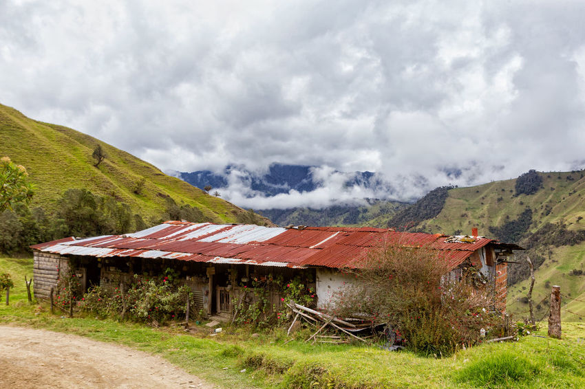 An old house with a rusty roof in the mountains outside of Salento, Colombia. Cloud Colombia Farm Hiking Palm Pasture Quindío Rural Tree Trip Andean Architecture Cauca Colombian  Countryside Forest Hike Jeep Landscape Old Quindío Salento Tolima Trek Wax