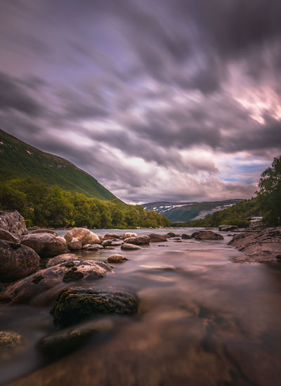 Long exposure of a river in Oppdal, Norway Norway Beauty In Nature Cloud - Sky Land Nature Outdoors Rock Rock - Object Scenics - Nature Sky Solid Tranquil Scene Tranquility Water