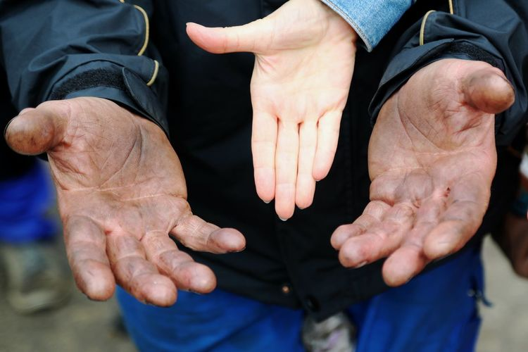 Close-up Day Hand Human Body Part Human Hand Outdoors Real People Senior Adult Strong Versus Soft Togetherness Two People White And Black
