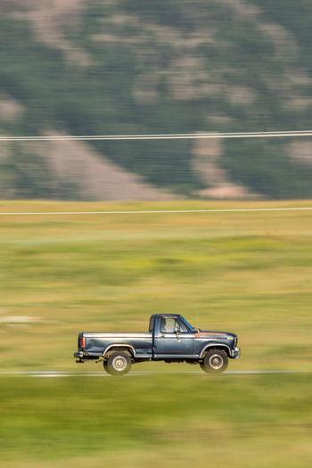Pick-up truck on field