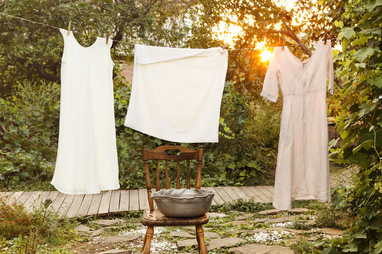 Clothes drying on clothesline in yard