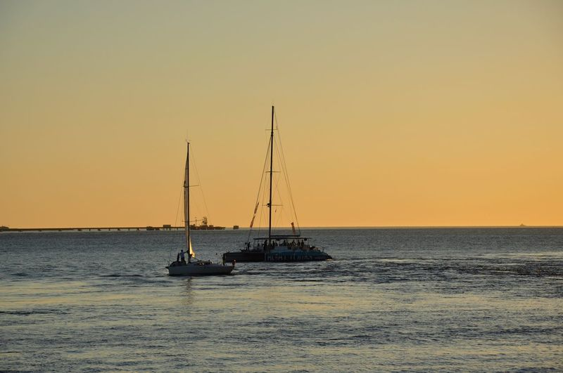 Time to go home Sunsets Nautical Vessel Sky Sea Water Transportation Sunset Mode Of Transportation Beauty In Nature Sailboat Clear Sky Scenics - Nature Horizon Over Water Horizon Waterfront Sailing Tranquility Orange Color Tranquil Scene
