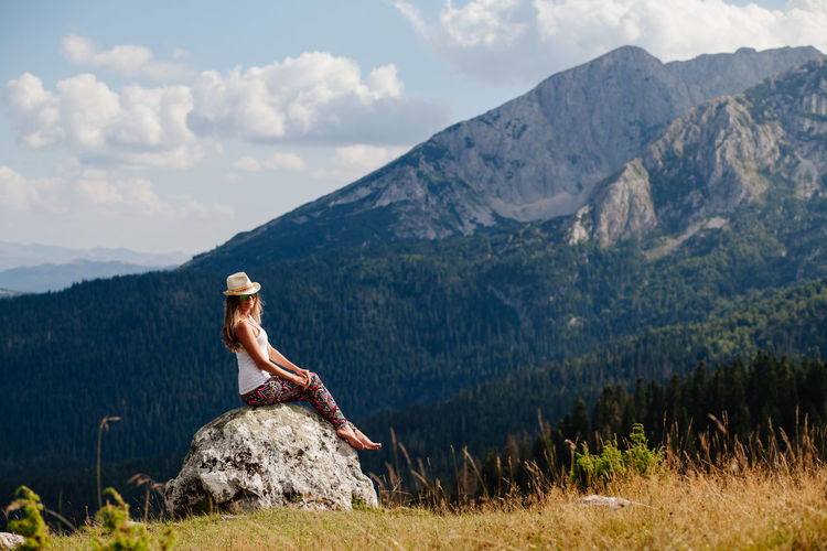 woman relax in mountains with lake and forest view. travel wild nature. Woman wearing casual travelling. Beautiful Casual EyeEm Best Shots Females Hat Relaxing Travel Travel Photography Traveling Travelling Woman Beautiful Woman Beauty In Nature Casual Clothing Countryside Forest Lake Leisure Activity Lesiure Activity Mountain Mountain Range Relaxing Moments Travel Destinations Woman Portrait
