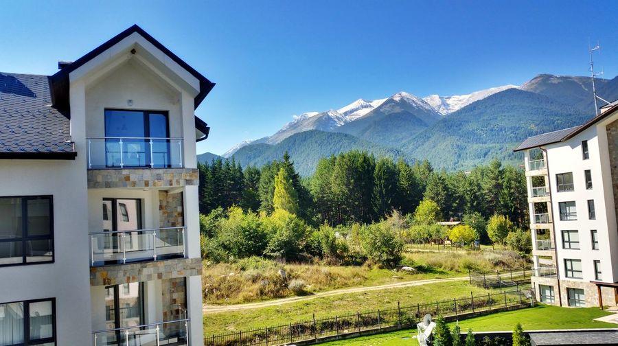 Houses on mountain range
