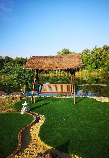Business Finance And Industry Blue Sky Tropical Climate Tropical Tropical Tree Tree Sky Grass Park - Man Made Space Hedge Park Bench Bench Patchwork Landscape Growing Garden Path Plant Life Outdoor Play Equipment