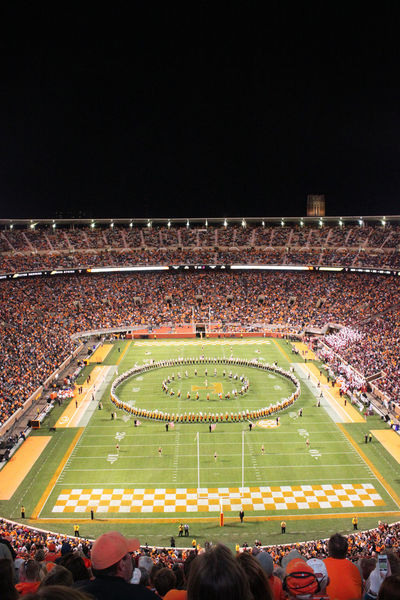 The University of Tennessee Pride of the Southland Marching Band doing halftime circle drill during Alabama game in 2012 Big Orange Crowd Football Formation Halftime Knoxville Large Group Of People Night Pride Of The Southland Marching Band Spectator Stadium University Of Tennessee The Color Of Sport