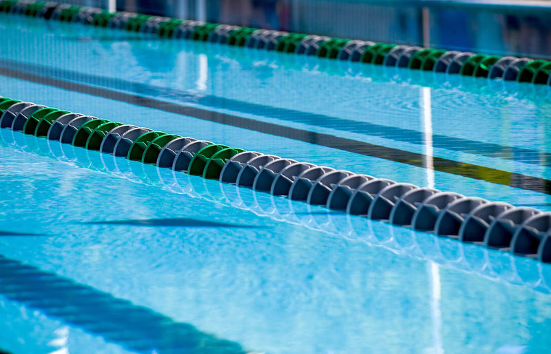Plastic floats create a swim lane in this outdoor pool, all set up for a swim competition