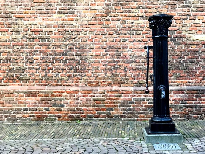 Water pump outside a church in Utrecht, Netherlands Copy Space Utrecht Holland Netherlands Water Pump Waterpomp Buurkerk Brick Brick Wall Wall Wall - Building Feature Built Structure Architecture No People Day Building Exterior Metal Outdoors Pattern Textured