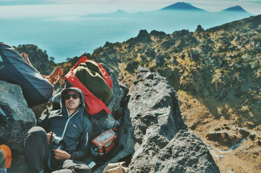 Mood.. Your Ticket To Europe Canonphotography Adventure Mountain Landscape Adult Rock - Object People Adults Only Only Men Sitting RISK One Man Only Day Outdoors Men Rock Climbing One Person Scenics Climbing Full Length Young Adult Human Body Part Hiking