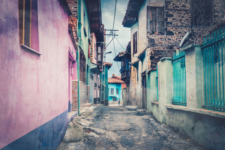 Old and colorful houses on the side of narrow streets. Architecture Building Exterior Built Structure Building Residential District The Way Forward Direction House City Street Alley Day Window Narrow Town No People Outdoors Footpath Wall Nature
