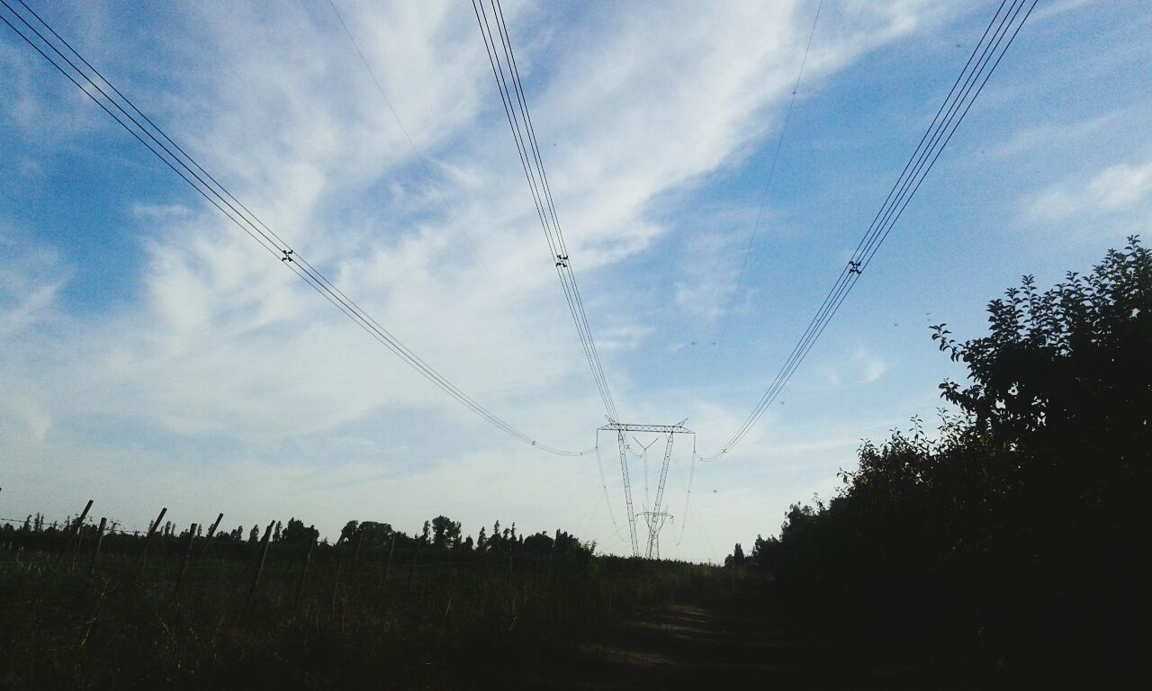 cable, power line, electricity, power supply, electricity pylon, fuel and power generation, sky, connection, low angle view, technology, no people, nature, field, cloud - sky, day, tree, vapor trail, silhouette, landscape, outdoors, telephone line, scenics, beauty in nature