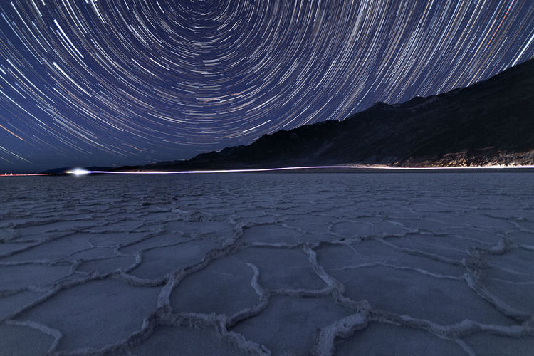 Scenic view of arid landscape against sky at night