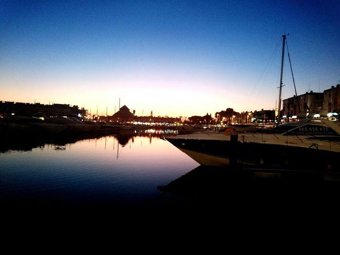 View of illuminated city at sunset