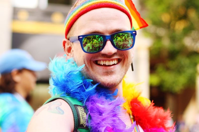Multi Colored Sunglasses Wig Smiling Celebration Happiness Focus On Foreground Real People Fun Day Headshot Lifestyles Cheerful Face Paint Leisure Activity Clown Portrait Looking At Camera Outdoors Men Jenae Rainbow Loveislove