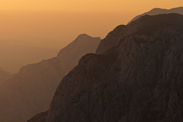 Scenic view of mountain against sky during sunset