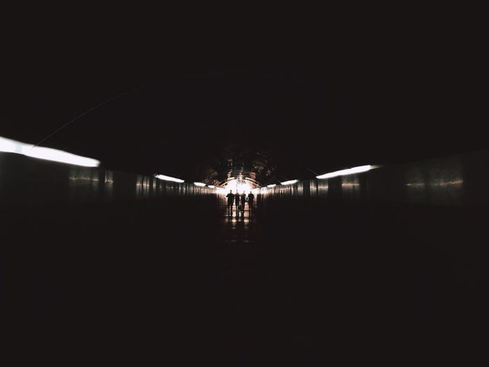 Illuminated tunnel in building at night