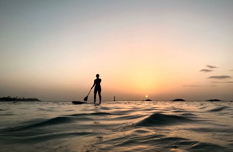 Sunset Paddleboarding Water Sea Sky Sunset Silhouette Real People One Person Beauty In Nature Lifestyles Scenics - Nature Orange Color Leisure Activity Beach Outdoors Nature The Mobile Photographer - 2019 EyeEm Awards The Great Outdoors - 2019 EyeEm Awards