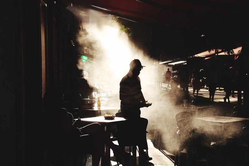 Steam Real People One Person Men Night Lifestyles Standing The Art Of Street Photography Silhouette Leisure Activity Water Illuminated Three Quarter Length Motion Wet Nightlife Nature Architecture Outdoors