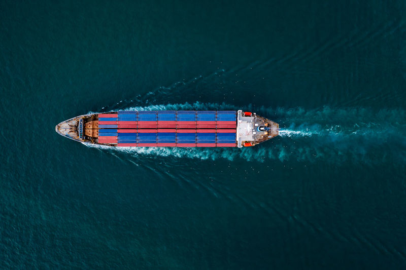 Aerial top view from drone, container ship or cargo shipping business service logistic