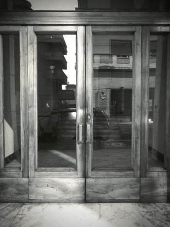 Doors I Walked Through Market Eyem Italia Building Exterior Reflection_collection Black And White Architecture Private Property Regularity Simmetrical Building Bauhaus Organic Architecture Twentieth Century Wood - Material Glass - Material Purity Architecture Built Structure Rationalism