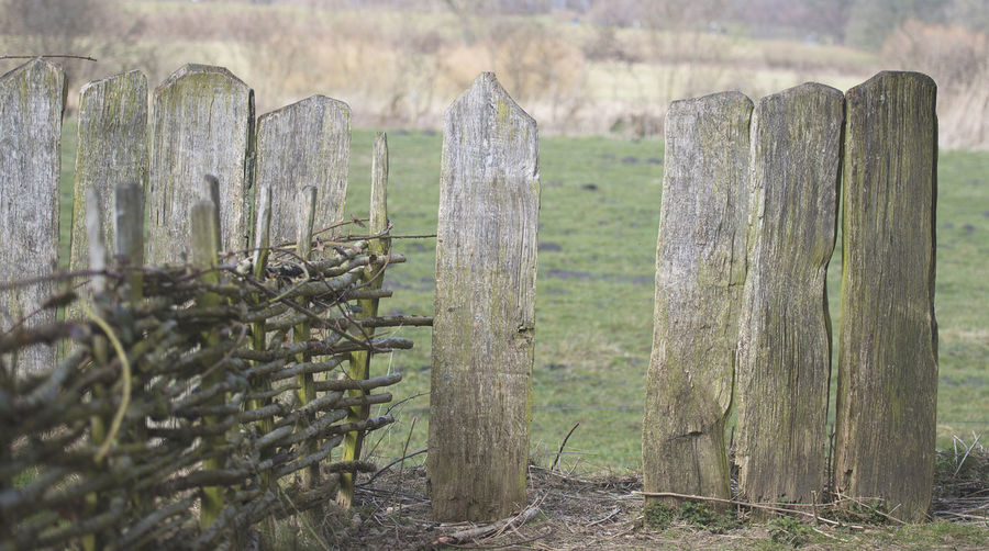 View of wooden fence on field