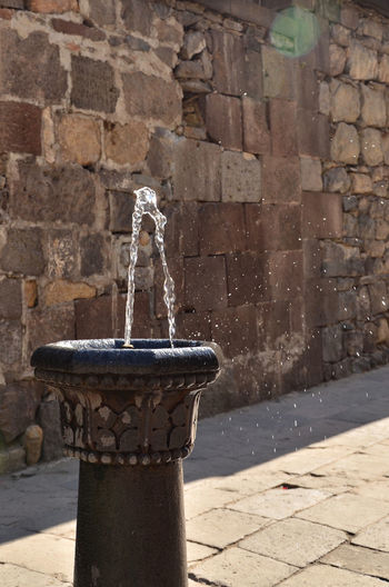 Armenia Geghard Geghard Monastery Architecture Building Exterior Built Structure Day Drinking Fountain Faucet Fountain Motion No People Oriental Orthodox Church Outdoors Religion Sculpture Shadow Spraying Statue Stone Material Sunlight Tap Travel Destinations W-armenien Water