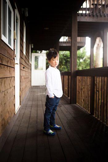 Portrait of boy standing at corridor