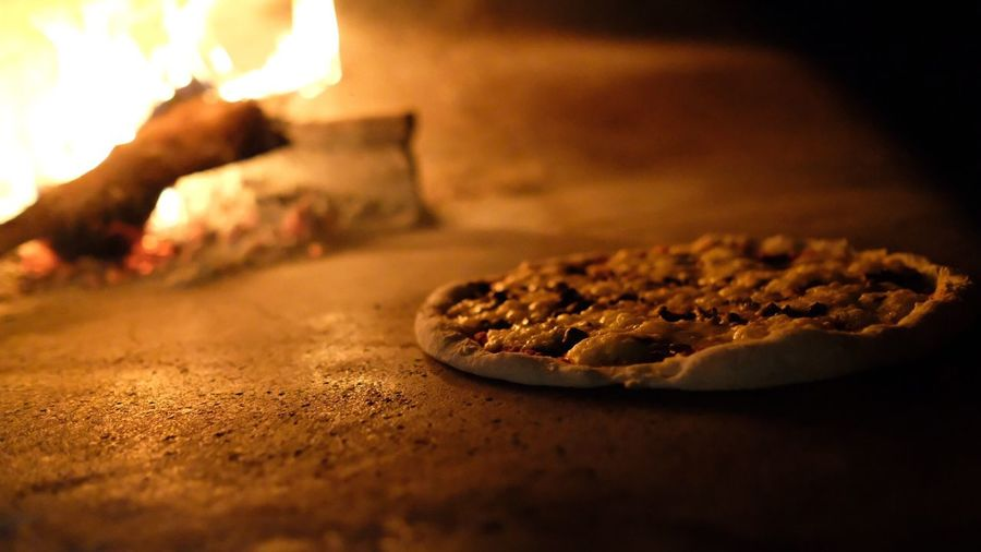 High angle view of pizza by fire