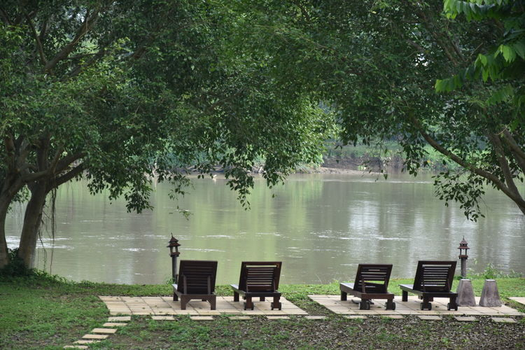 Beauty In Nature Branch Chaingrai Chair Day Full Length Kokriver Lake Men Nature Outdoors People Reflection River Riverview Social Issues Tranquility Tree Water