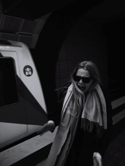 Woman standing against subway train
