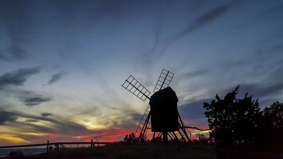 The old windmill at Byxelkrok, Öland in the Swedish Baltic Sea. Baltic Sea Alternative Energy Architecture Beauty In Nature Built Structure Cloud - Sky Environment Environmental Conservation Fuel And Power Generation Nature No People Non-urban Scene Outdoors Plant Renewable Energy Silhouette Sky Sunset Traditional Windmill Tree Turbine Wind Power Wind Turbine
