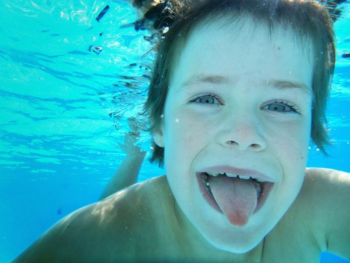 Close-up portrait of child in swimming pool