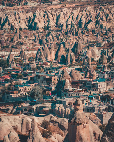Aerial view of houses amidst rock formations