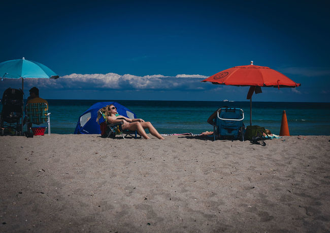 Solar Exposure Beach Life Beach Photography GFX50s Relaxing Beach Umbrella Candid Photography Cloud - Sky Day Florida Fujifilm Fujifilm_xseries Leisure Activity Outdoors People Photographyisthemuse Sand & Sea Young Adult Young Woman