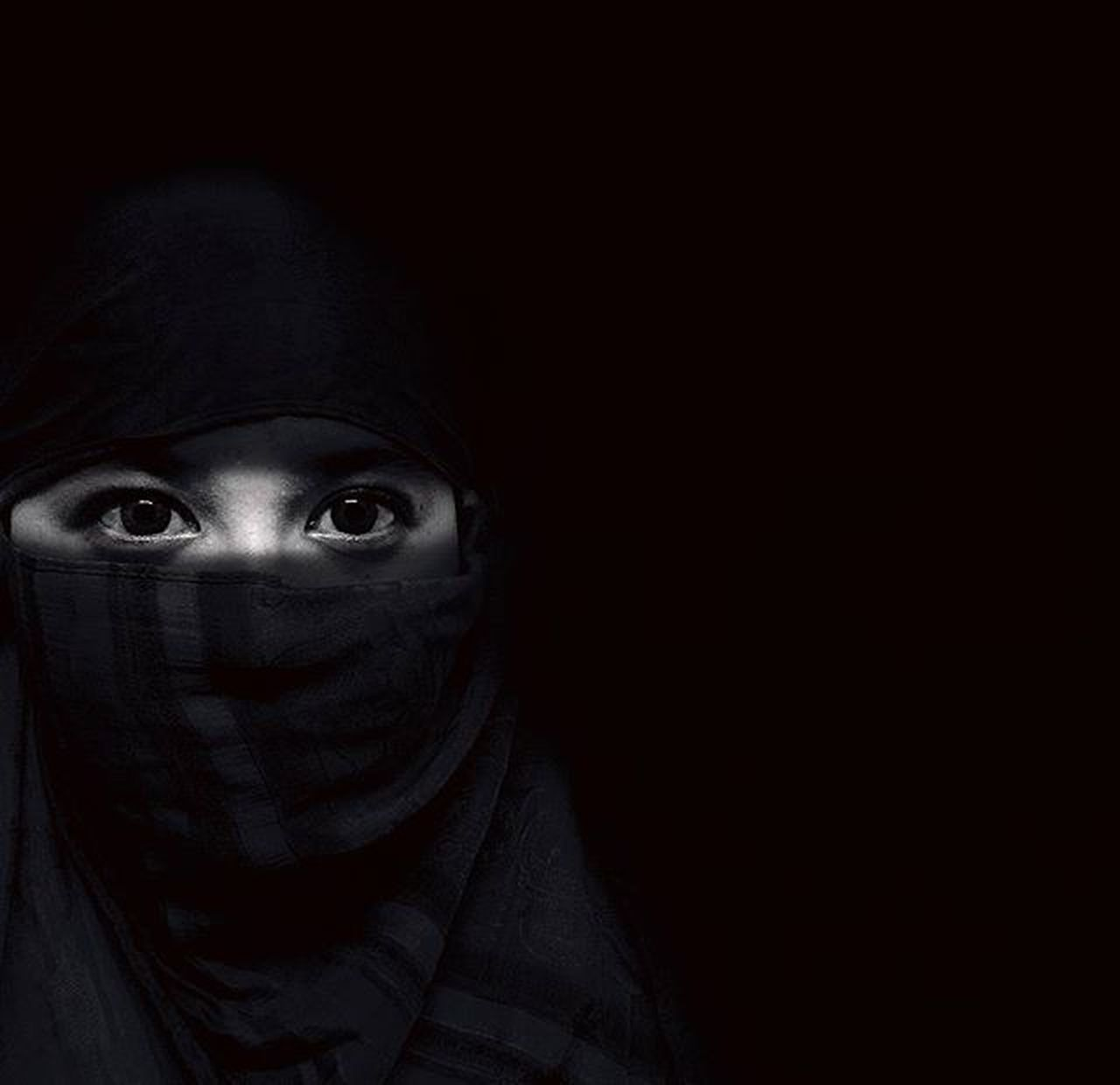 looking at camera, spooky, portrait, headshot, black color, halloween, one person, horror, adult, front view, adults only, human face, people, night, evil, human eye, one woman only, human body part, black background, only women, young adult