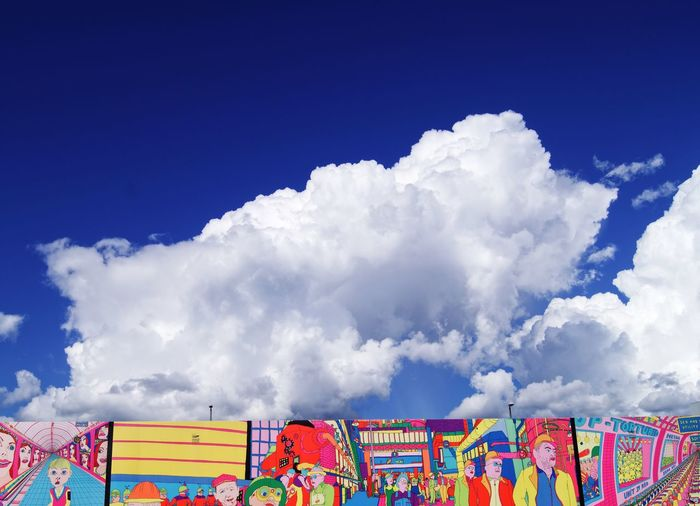 Billowing clouds over Pushwagner art mural in Filipstad, Oslo Billowing Clouds Art Filipstad Oslo Art Mural Art Mural Pushwagner Cloud - Sky Sky Multi Colored Blue Day Nature No People Outdoors Building Exterior