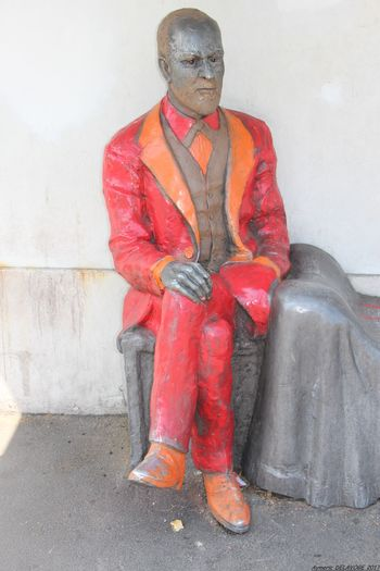 Adult Men Celebrities Freud Sculpture In The City Bus Station One Man Only Only Men People Front View One Person Mature Adult Adults Only Red Full Length Standing Day Outdoors
