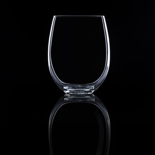 Close-up of empty glass against black background