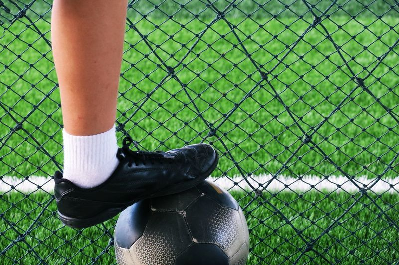 Sport field and football and soccer player Football Football Stadium Football Field Football Game Soccer Soccer Field Soccer Player Soccer Ball Game Playing Sport Green Fields Ball Leisure Activity Activity Stadium Human Leg Grass Human Body Part Standing Shoe Body Part Lifestyles Human Foot Physical Activity Fence Goals Baseball Net Team