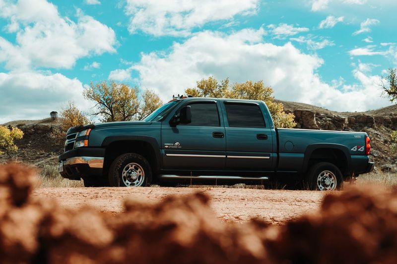 Chevy Truck ChevySilverado Chevy Truck Chevy EyeEm Selects Mode Of Transportation Motor Vehicle Car Land Vehicle Transportation Sky Cloud - Sky Nature Sunlight Day Land Outdoors Plant No People Road Tree Field Beauty In Nature Landscape Environment
