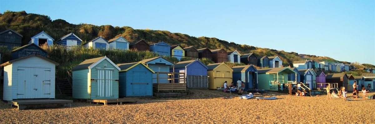 Architecture Beach Blue Building Exterior Built Structure Clear Sky Coloured Houses Copy Space Day Great Britain House Huts Hütte Landscape_Collection Large Group Of People Outdoors Panorama Sand Shore Sky Strand Summer Sunlight Sunny Vacations