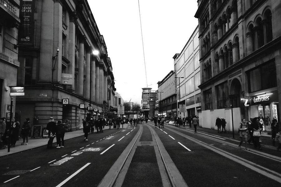 City vibes. Architecture EyeEm Photography United Kingdom Monochrome Photography Blackandwhite The Great Outdoors With Adobe Black & White Photography Blackandwhite Photography Monochrome Photograhy Urban Road Urban Skyline Manchester Empty Road Outdoors Building Exterior City Cityexplorer Built Structure Travel Destinations Large Group Of People Illuminated AndroidPhotography Android Sky The Street Photographer - 2017 EyeEm Awards